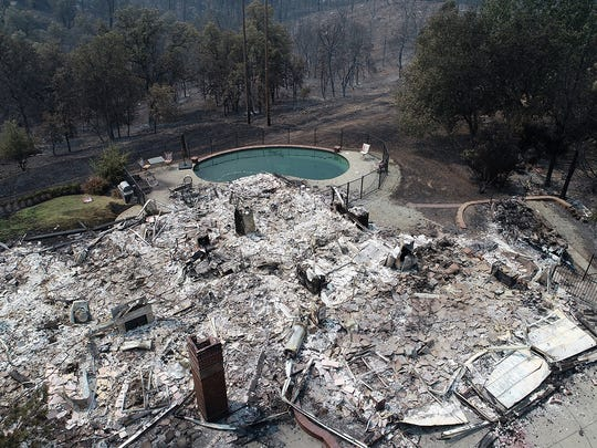 Homes in the River Ridge Park subdivision show the damage from the Carr Fire Wednesday August 1, 2018 in Redding, CA. This home at 3492 Showboat Ct. is completely destroyed.