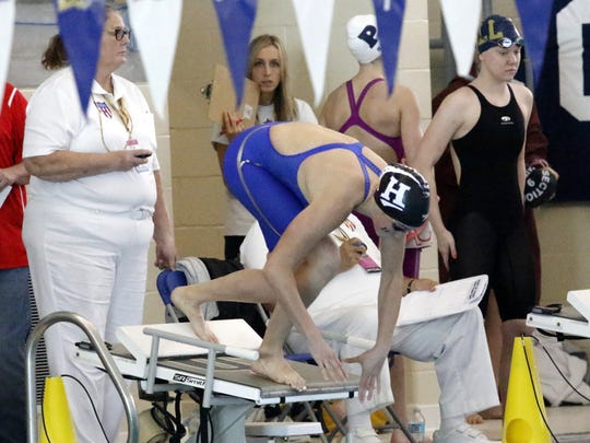 Maddy Rogan of Horseheads jumps off the starting block during the 100-yard freestyle preliminaries Friday at the New York State Girls Swimming and Diving Championships at Ithaca College.