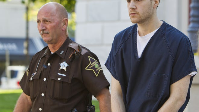 Cody Cousins is escorted from the Tippecanoe County Courthouse Friday, Sept. 19, 2014, after his sentencing for the murder of Purdue University student Andrew Bolt last January. Cousins received the maximum sentence of 65 years in prison.