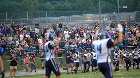 Mitchell players and fans celebrate a big play on Sept. 11.