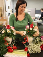 Ruth Messmer Florist co-owner Jessica Gnagey designs petite floral arrangements for the upcoming Valentine's Day holiday Tuesday in Fort Myers.