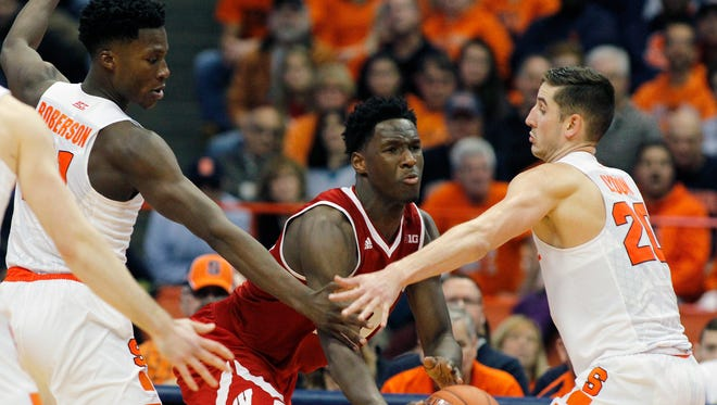 Nigel Hayes passes against Syracuse in this Dec. 2015 file photo.