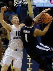 Marquette's Sam Hauser defends against Villanova's