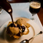 """The Harry Waugh Dessert Room opened in 1985 and reservations are recommended. Within your private """"wine cask,"""" enjoy one of the nearly 50 decadent desserts prepared by Bern's 20-person pastry team. Pictured here, the macadamia nut ice cream."""