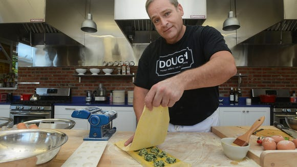 Chef Brian Ross at Dough on Merrimon Avenue. The market