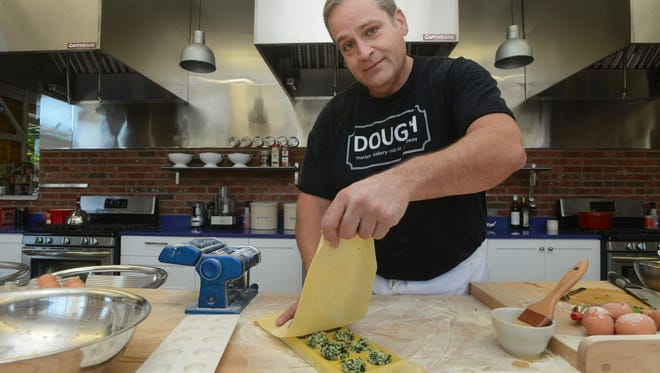 Chef Brian Ross at Dough on Merrimon Avenue. The market is now closed.