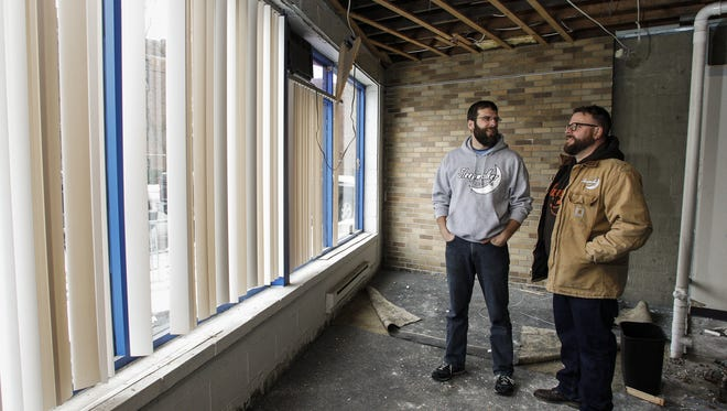 Matt Jason and Jeremy Sprague of Sleepwalker Spirits and Ale inside the future taproom and bar area of their new location near the corner of Shepard and Kalamazoo streets in Lansing.