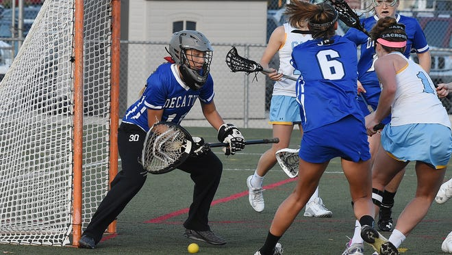 Cape Henlopen HS (white) hosted Stephen Decatur (blue) in Girls Varsity Lacrosse at Champions Stadium on Monday April 11 at the school near Lewes.