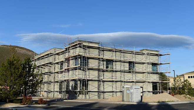 A commercial real estate building under construction at Reno Corporate Center on Longley Lane and Double R Blvd on April 13, 2016.