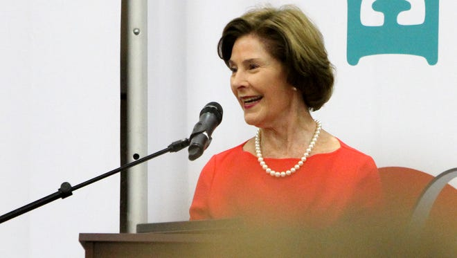 Former first lady Laura Bush gives a speech at Heart of a Woman Saturday, Feb. 4, 2017, in the MPEC Exhibit Hall.