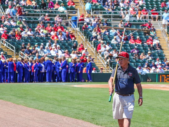 Toma pulls his rake and the rest of the crew off the field before the game starts. George Toma, 88, has been working the Hammond Stadium field for 17 years now. At age 88, Toma has been the head groundskeeper at every Super Bowl, and he has no plans to retire. This year, he has been joined by one of his three sons. Chip Toma, has been hired by Lee County as a groundskeeper and is in charge of field No. 3 on the minor league side. Like his father, Chip Toma's resume makes him look a bit overqualified for his new job. He has done a soccer field in Brazil for Pele, also worked on Super Bowls and even once crossed paths with the Beatles in their 1965 primes.