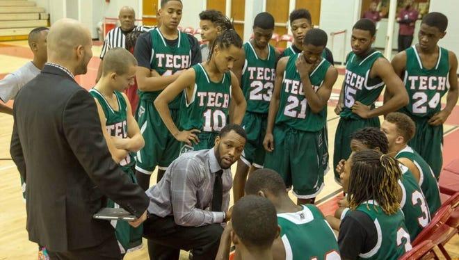 Keith Dabney (center, kneeling) has been named the boys basketball coach at Tech.