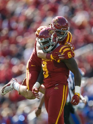 Iowa State's Levi Peters jumps on teammate Jhaustin Thomas after he sacked Kansas quarterback Montell Cozart during their game at Jack Trice Stadium in Ames on Saturday, October 3, 2015.