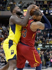 Indiana Pacers guard Lance Stephenson (1) ties the ball up for a jump ball with Cleveland Cavaliers forward LeBron James (23) during the second half of Game 4 at Bankers Life Fieldhouse on Sunday, April 22, 2018. The Cleveland Cavaliers defeated the Indiana Pacers 104-100.