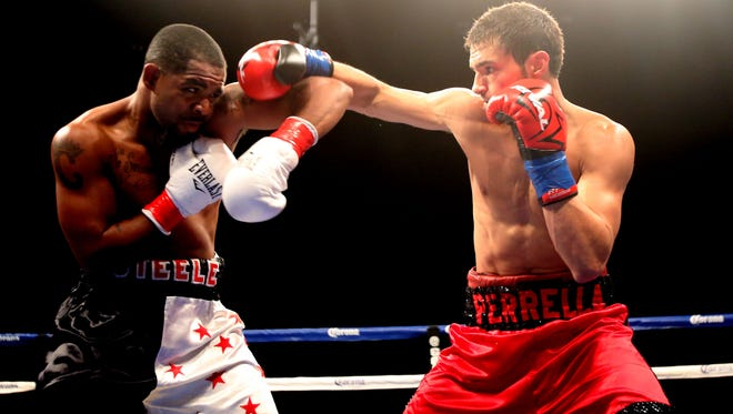 Bryant Perrella pressures Cristian Steele in the second round at Fantasy Springs Resort and Casino in Indio, Calif. on Friday. Perrella won the fight after referee Jack Reiss calls off the fight after a third knockdown by Perrella. Perrella remains undefeated with a record of 6-0 with 5 KOs.