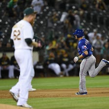 OAKLAND, CA - SEPTEMBER 17:  J.P. Arencibia #7 of the Texas Rangers rounds the bases after hitting a three-run homer off of Sean Doolittle #62 of the Oakland Athletics in the top of the ninth inning at O.co Coliseum on September 17, 2014 in Oakland, California.  (Photo by Thearon W. Henderson/Getty Images)