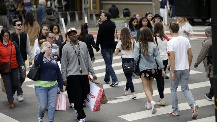 Shoppers cross a street Nov. 22, 2015, in San Francisco.
