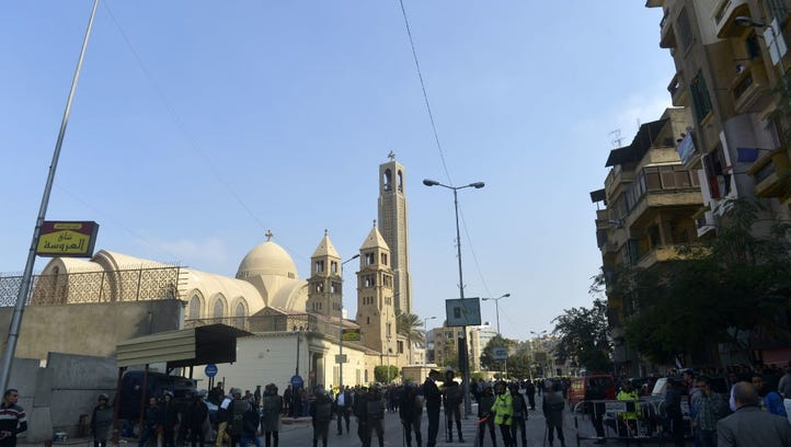Egyptian security forces gather at the site of an explosion