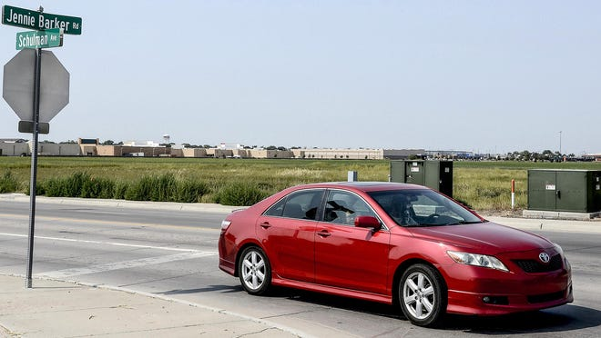 A motorist makes their way from Schulman Avenue on to Jennie Barker Road. The open lot at the intersection is the proposed site of a new fire station on the east side of Garden City.