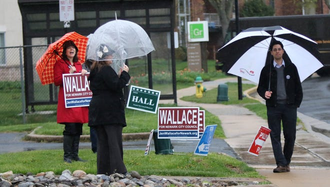 From left, Amy Roe, District 3 candidate Jennifer Wallace and Councilman Rob Gifford greet voters outside of the Aetna fire station voting site for the Newark council elections on Tuesday, April 12, 2016.