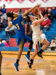 St. Clair's Julianna Cataldo (right) is blocked by