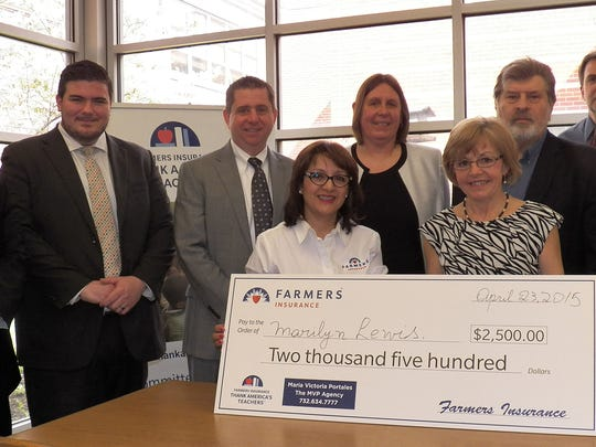 A Farmers Insurance Thank America's Teachers event was conducted on April 23 at Edgar Middle School in Metuchen. The event honored special education and reading teacher Marilyn Lewis' winning proposal with a $2,500 educational grant used to help fund classroom supplies for her students. Lewis' proposal focused on connecting her students through computers, specifically through the purchase of laptops for her classroom. Lewis believes her students need to be able to go beyond the text and actively research meanings in order to make sense and more deeply comprehend the concepts and ideas they are learning. Pictured from left to right at the event are: Anthony Breen, Farmers Insurance Agency distribution manager; Michael Gervasio, Farmers Insurance Northern NJ performance manager; Maria Victoria Portales, Farmers agent in Woodbridge; Marilyn Lewis; Dr. Vincent Caputo, Metuchen Superintendent of Schools; Kathryn Glutz, principal, Edgar Middle School; Tom Vahalla, Mmyor of Metuchen; Robert Capra, director of special services; and Brian Stike, assistant principal of the Edgar Middle School. For details, visit the ThankAmericasTeachers.com website.