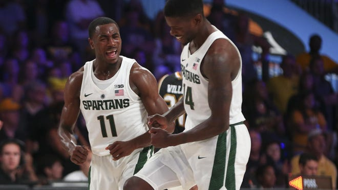 Michigan State's Tum Tum Nairn Jr. (11) celebrates with Eron Harris (14) during the Spartans' win over Wichita State on Friday in Nassau, Bahamas.