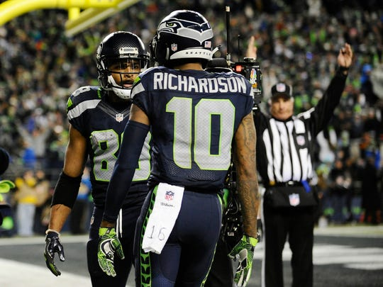 Seattle Seahawks wide receivers Paul Richardson and Doug Baldwin celebrate a touchdown against the Detroit Lions during the second half of an NFC Wild Card playoff game on January 7 at CenturyLink Field.