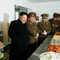 North Korean leader Kim Jong-un enjoys his Dec. 1 visit to an artillery unit at an undisclosed location.