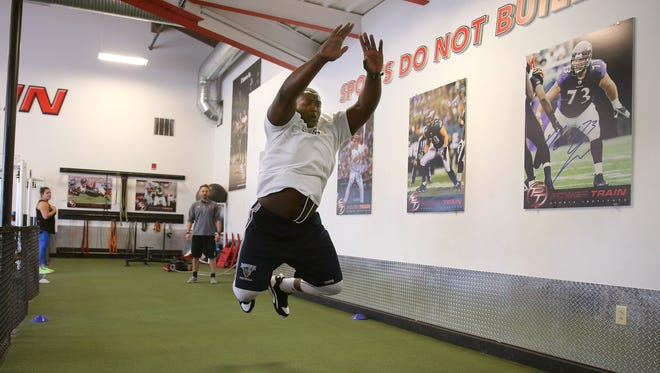 Bruce Johnson, a Gates- Chili graduate, works out at Power Train in East Rochester, and hopes to be taken in the upcoming NFL Draft.