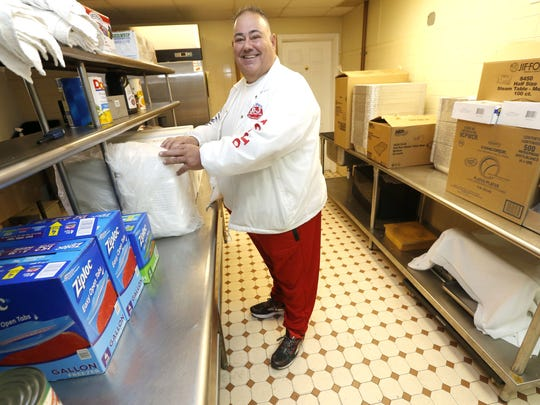 """John Merla from Keyport Knights of Columbus, prepares kitchen for """"Friends of the Bayshore,"""" which will feed 1,200 Bayshore residents a free Thanksgiving dinner. The grassroots volunteer effort is in its eighth year.  Keyport, NJ. Monday November 20, 2017."""