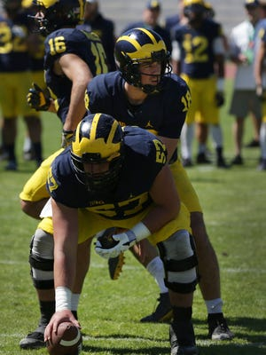 Michigan QB Brandon Peters takes the snap from Patrick Kugler at Stadio dei Marmi in Rome on April 29, 2017.