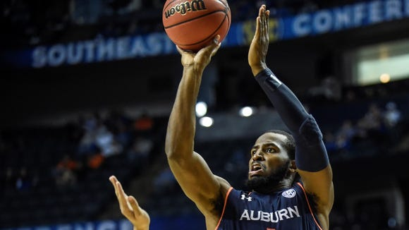 Senior KT Harrell scored 25 points in leading Auburn past Texas A&M, 66-59, Thursday in the SEC tournament in Nashville.