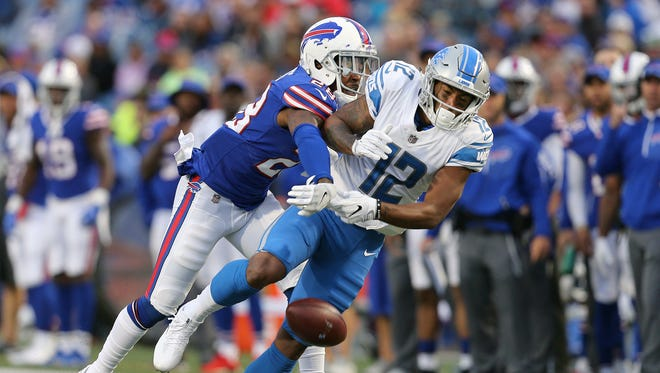 Bills E.J. Gaines knocks away a pass intended for Lions receiver Noel Thomas.