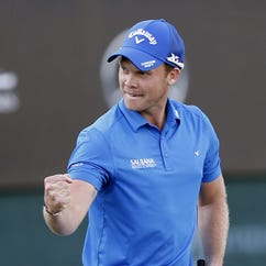 Danny Willett of England celebrates after winning the Dubai Desert Classic.