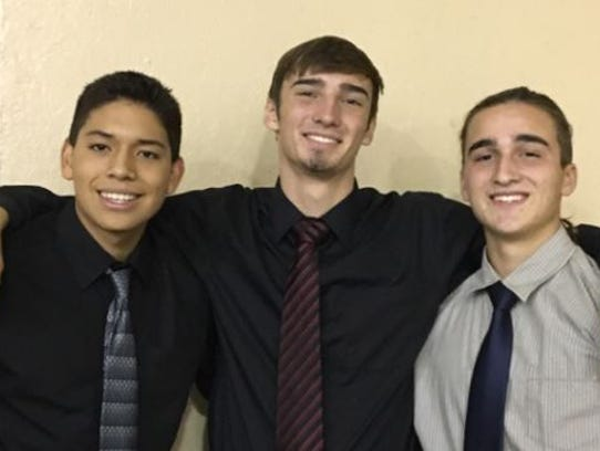 Josh Blauser (center) poses with friends Diego Cerron