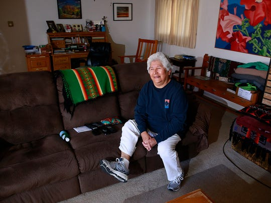 Nellie Sandoval, a breast cancer survivor and coordinator for the American Cancer Society's Reach to Recovery program, relaxes at her home in Farmington on Oct. 20.