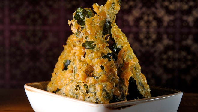 Chauhan's Kale Pakora Chaat, deep-fried kale chips, get their addictive crunch from a batter of chickpea flour.