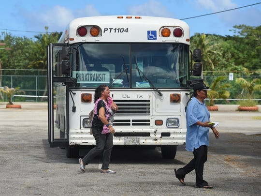 A Guam Regional Transit Authority Paratransit Service bus drops riders in this Nov. 8, 2017, file photo.