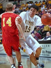 JJ Tauai drives to the basket during the 2003 Class