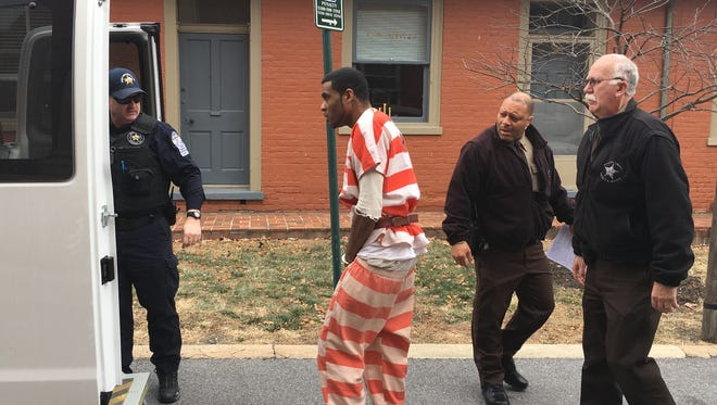 Derek M. Bell, 29, of Staunton, is placed into a jail van following his 10-year sentence Friday in Augusta County Circuit Court for beating a woman and injuring their child during the attack.