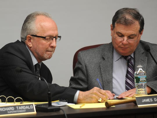 Clifton school board trustee Jim Daley, at right, and