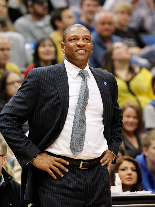 """FILE - In this March 31, 2014, file photo, Los Angeles Clippers head coach Doc Rivers smiles during the first quarter of an NBA basketball game against the Minnesota Timberwolves in Minneapolis. Steve Ballmer is officially the new owner of the Clippers. The team says the sale closed Tuesday, Aug. 12, 2014,  after a California court confirmed the authority of Shelly Sterling, on behalf of the Sterling Family Trust, to sell the franchise. Rivers calls it """"an amazing new day in Clippers history,"""" and says he's inspired by Ballmer's passion for the game. (AP Photo/Ann Heisenfelt, File)"""