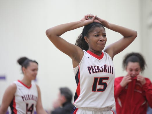 Peekskill's Adriane Jackson (15) reacts to their 47-62 loss to Maine-Endwell in the Class A girls basketball regional finals at New Rochelle High School on March 8, 2014.