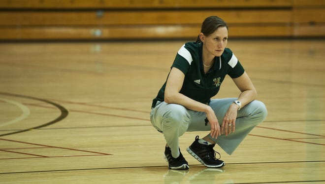 UVM women's basketball coach Lori McBride watches her team practice last week. McBride made some wholechanges to her program following another disappointing season, her fifth at the helm.