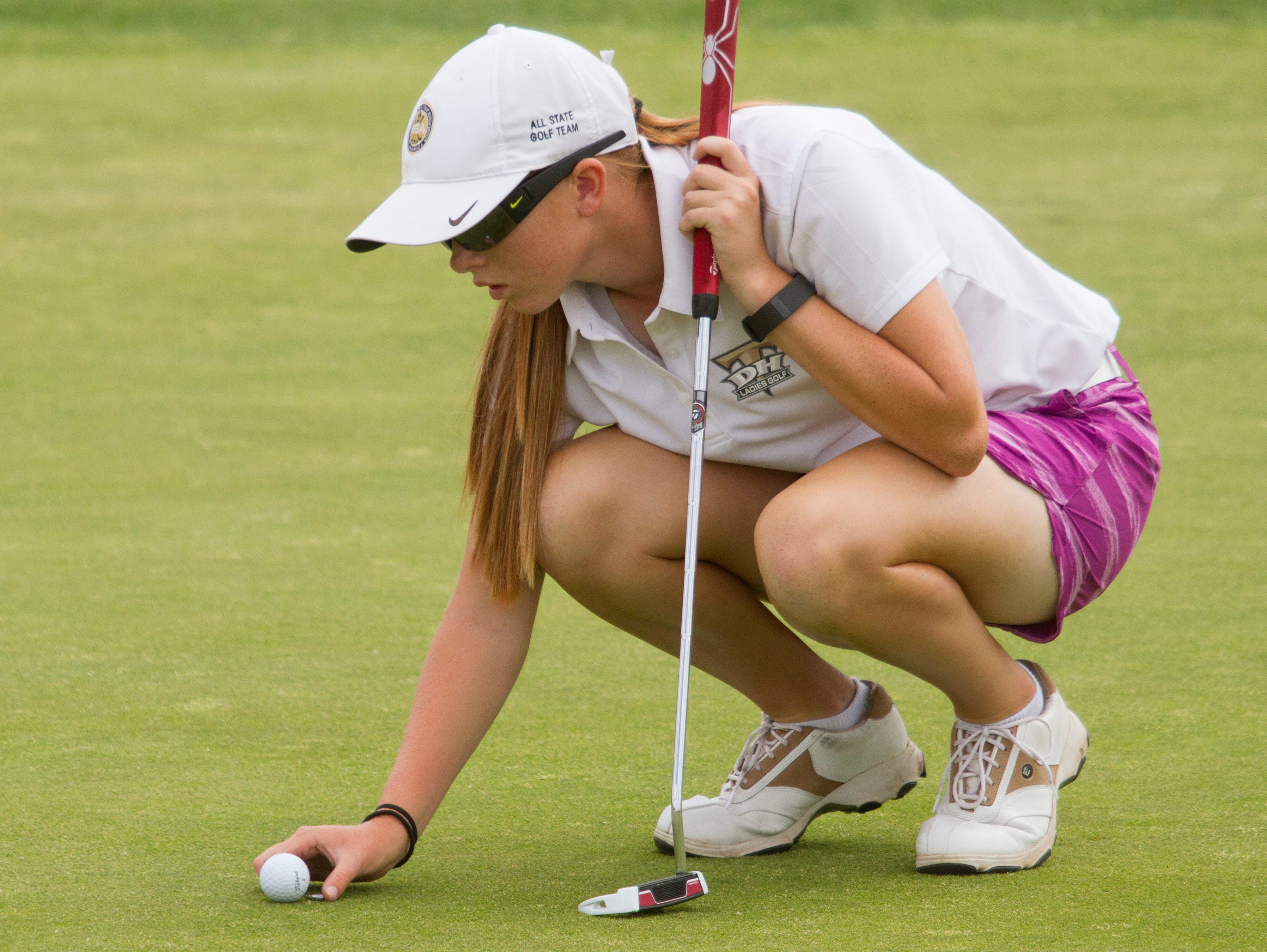Desert Hills golfer Tori Thomas looks to make a putt at SunRiver Golf Club. The Thunder are looking to win its seventh consecutive state title this week at Soldier Hollow.