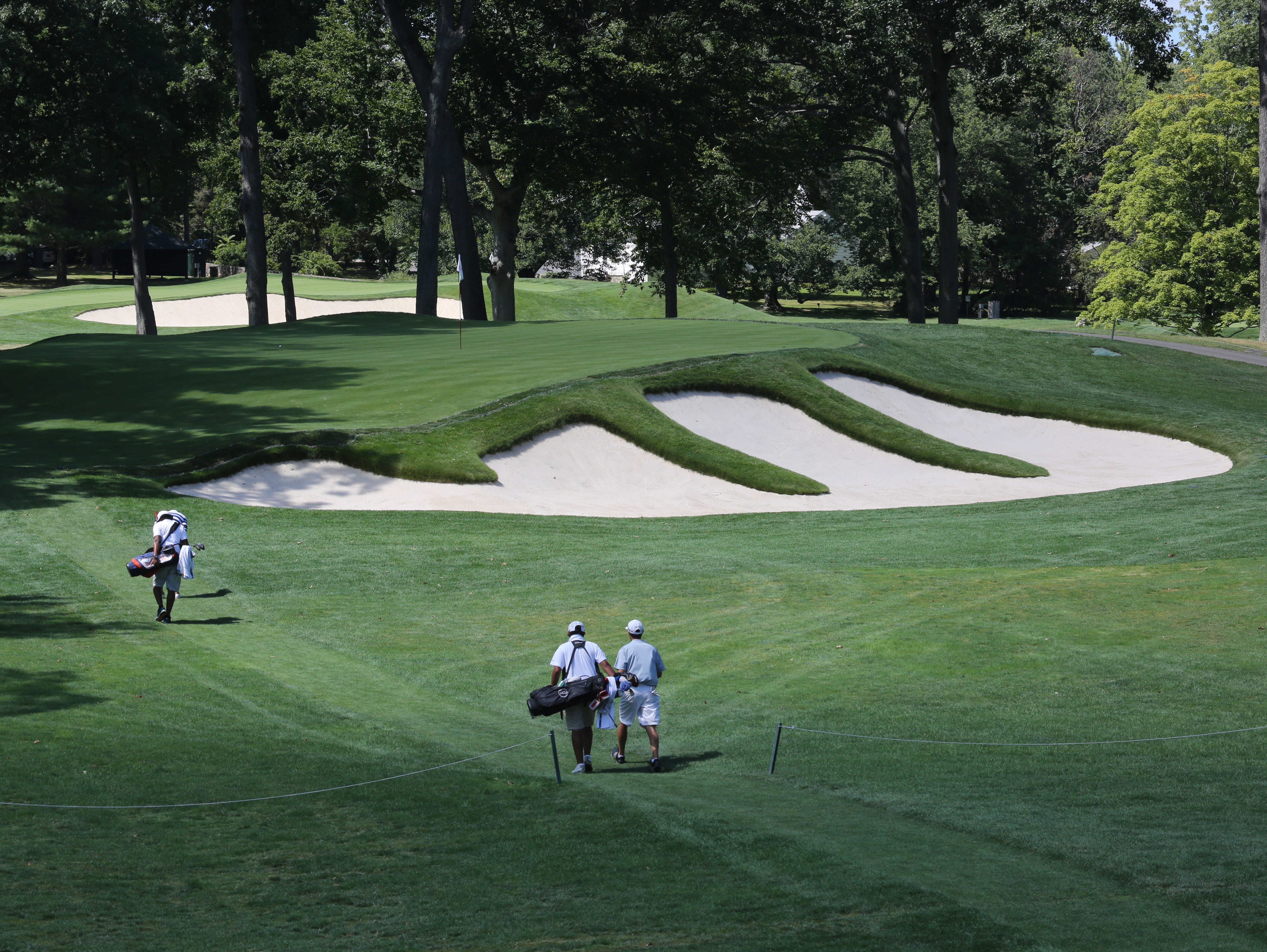 The approach to the 13th green on the East Course at the Winged Foot Golf Club in Mamaroneck, Aug. 13, 2015. The East Course, recently restored, is hosting the USGA Four-Ball Championship next spring.