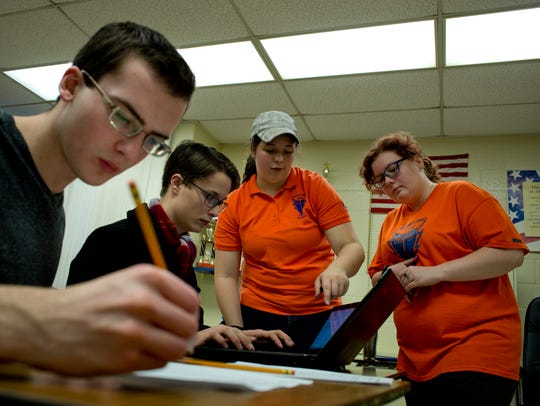 Almont team members Jerod D'Epifanio, 17, Chris LaFramboise,