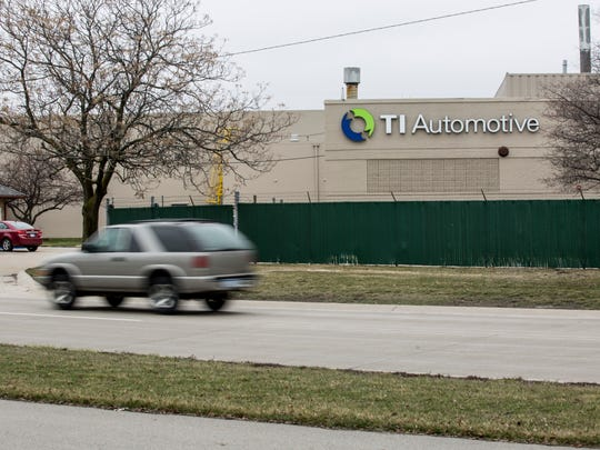 Vehicles pass by TI Automotive Tuesday, March 15, 2016 along Gratiot Avenue in Marysville. The city has created a new industrial development district bordered by Gratiot Avenue, Ravenswood Road, and train tracks to the west. TI Automotive is currently the only manufacturing company within the district, which is surrounded by vacant lots.