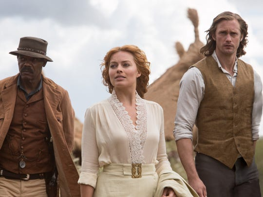 "George (Samuel L. Jackson, left), Jane (Margot Robbie) and Tarzan (Alexander Skarsgård) venture into the jungle in ""The Legend of Tarzan."""